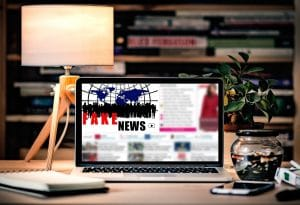 laptop with fake news image for advertsing and fake news blog